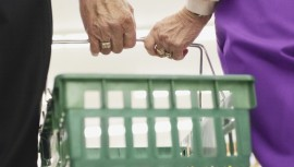 Couple Holding Shopping Basket
